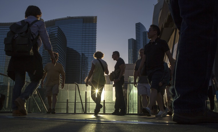 Image: People walk on the Las Vegas strip