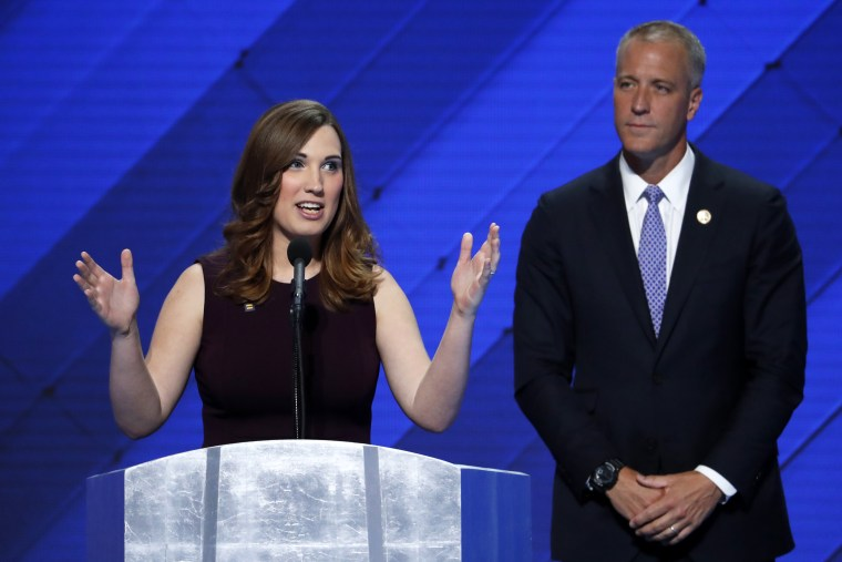 In this July 28, 2016 file photo, LGBT rights activist Sarah McBride speaks as Rep. Sean Patrick Maloney, D-NY, Co-Chair of the Congressional LGBT Equality Caucus listens during the final day of the Democratic National Convention in Philadelphia.