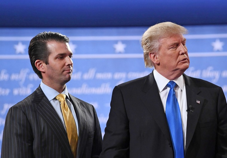 Image: Donald Trump (R) standing with his son Donald Trump Jr.