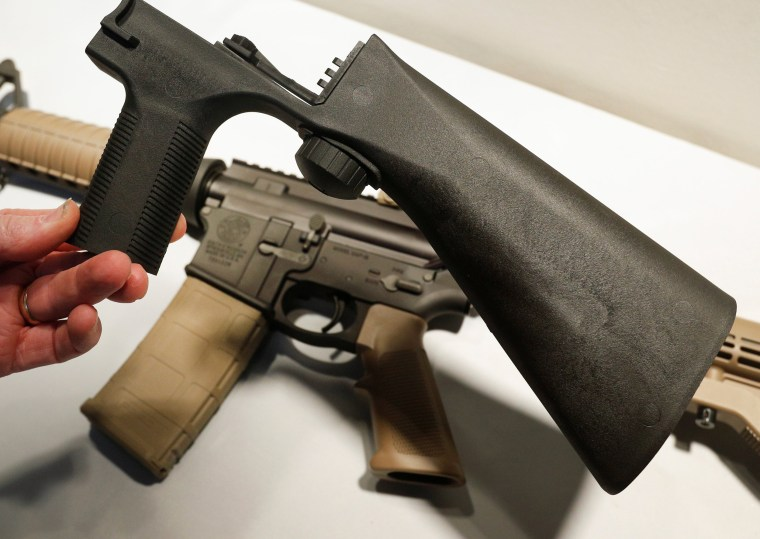 Image: A bump fire stock that attaches to an semi-automatic assault rifle to increase the firing rate is seen at Good Guys Gun Shop in Orem