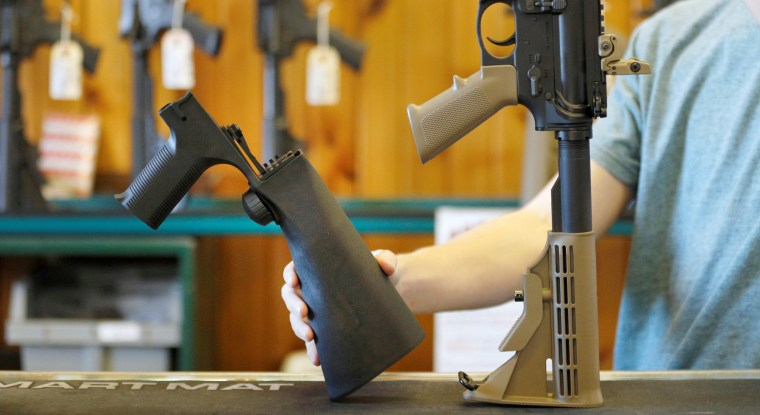 A bump fire stock that attaches to a semi-automatic rifle to increase the firing rate is seen at Good Guys Gun Shop in Orem