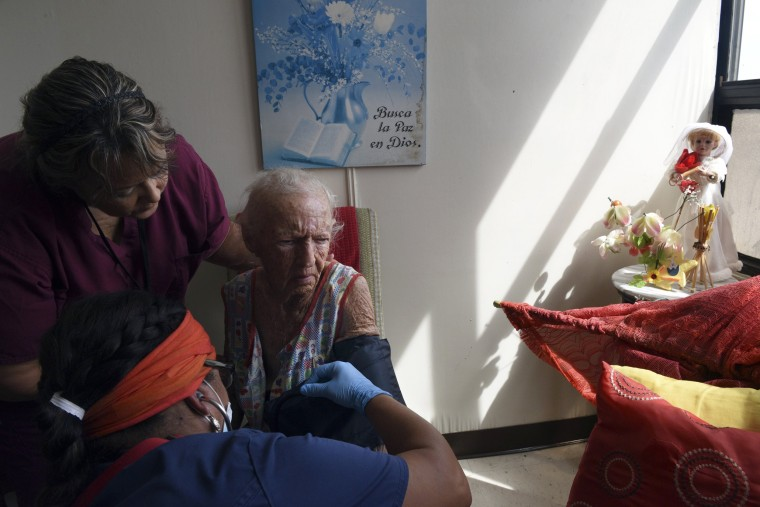 Image: Sandra Alvarez, a doctor from Daytona Beach, Florida examines Mercedes Perez