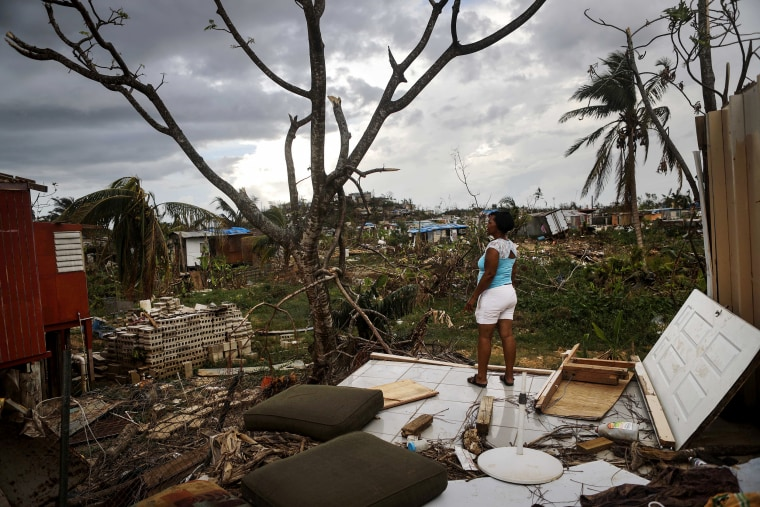 Image: Resident Mirian Medina stands on her property about two weeks after Hurricane Maria swept through the island on Oct. 5, 2017 in San Isidro, Puerto Rico.
