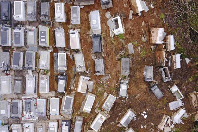 Image: Washed away coffins cover a hill after a landslide in Lares, Puerto Rico