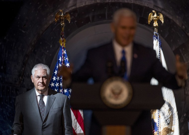 Image: Secretary of State Rex Tillerson listens as Vice President Mike Pence speaks