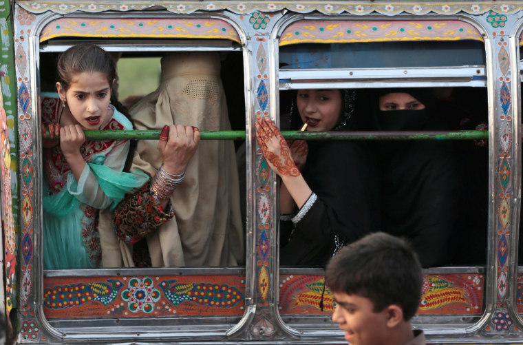 Image: Women ride in a van in Rawalpindi, Pakistan