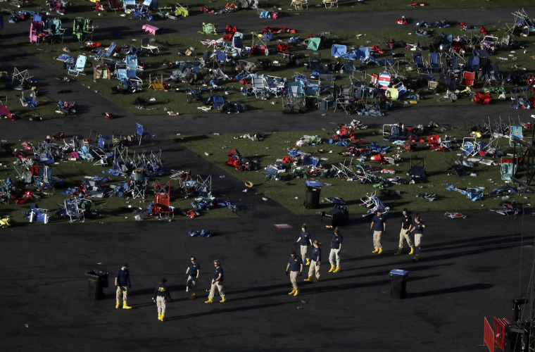 Image: Investigators work at the scene of the shooting on the festival grounds in Las Vegas