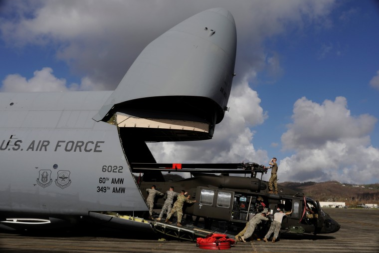Image: Soldiers work to unload a UH-60 Blackhawk helicopter to aid in recovery efforts following Hurricane Maria in Roosevelt Roads