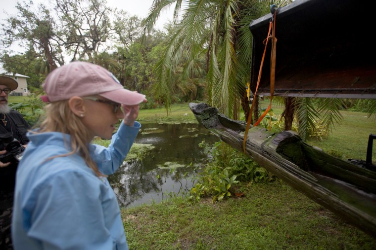 Image: An ancient canoe that washed ashore after Hurricane Irma is analyzed.