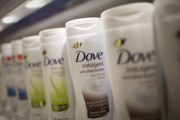 Image: Bottles of Dove body lotion.