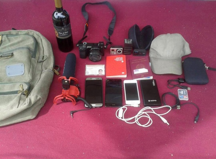 Image: Items belonging to journalists Jesus Medina, Roberto Di Mateo and Filippo Rossi, arrested at Tocoron, Venezuela are displayed on a table