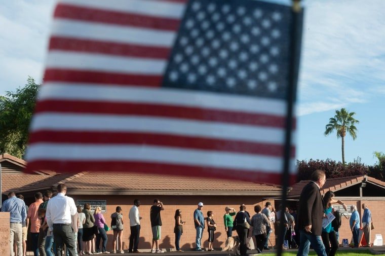 Arizona: Voters wait in line in front of a polling station to cast their ballots in the US presidential election in Scottsdale