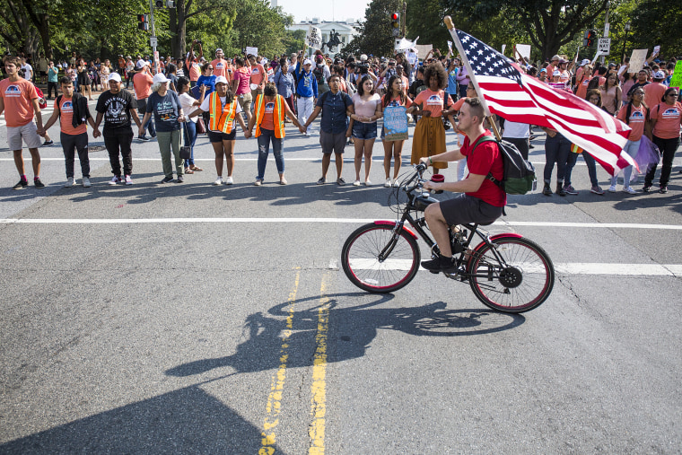Image: Demonstrators block traffic during a rally in support of DACA