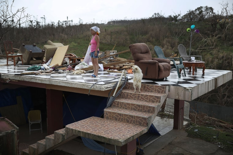 Image: Irma Maldanado stands in what is left of her home in Corozal, Puerto Rico