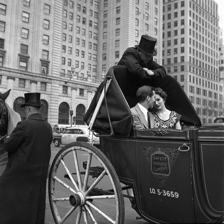Image: A couple rides in a horse-drawn carriage in New York, 1953.
