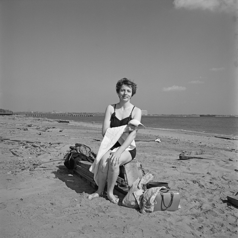Image: Maier in a self-portrait on a beach in New York's Staten Island, 1954.