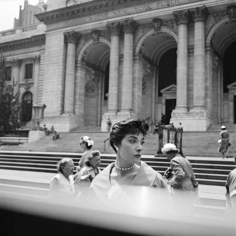 Image: A woman stands outside the New York Public Library in New York, 1953.