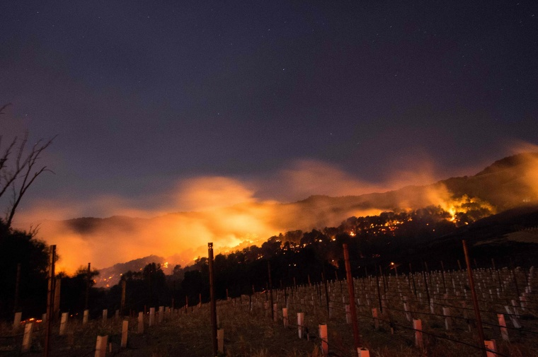 Image: Fire glows on a hillside in Napa