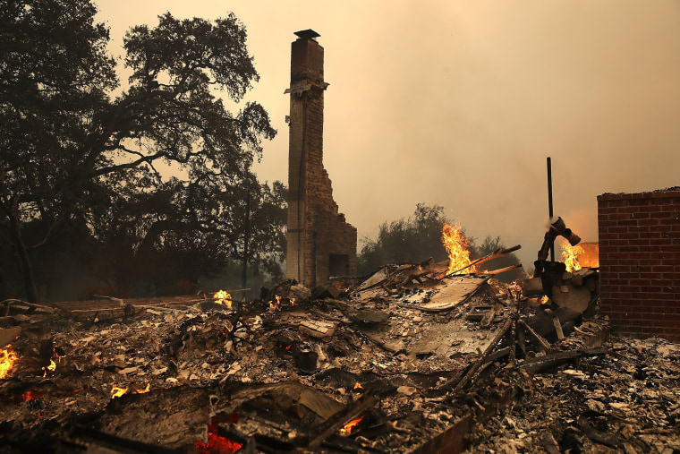 Image:  The remains of fire damaged homes after an out of control wildfire moved through the area