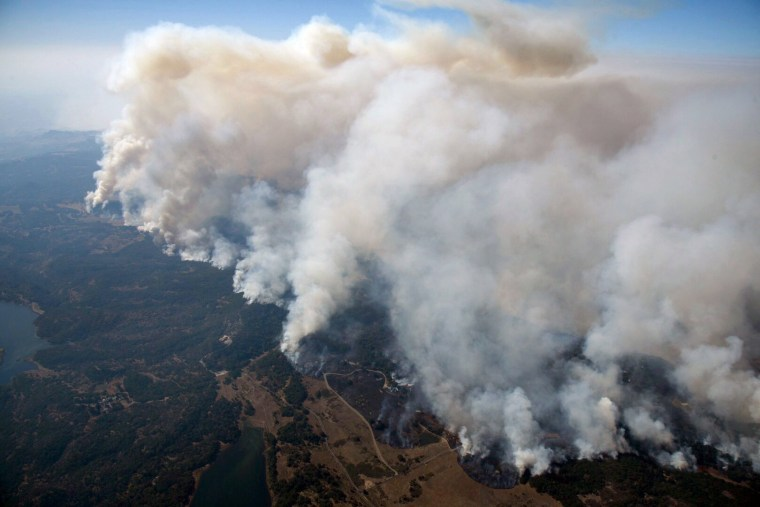 Image: Smoke rises as a wildfire burns in the hills north east of Napa