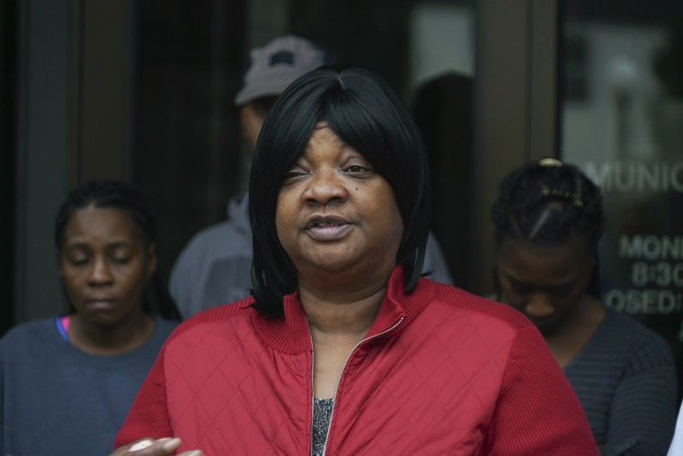 Mary Stewart, mother of Luke Stewart, speaks in front of Euclid City Hall in Euclid, Ohio on Monday, Oct. 9, 2017.  The family of Luke Stewart, an unarmed black driver fatally shot by a white policeman, has filed a federal civil rights lawsuit.