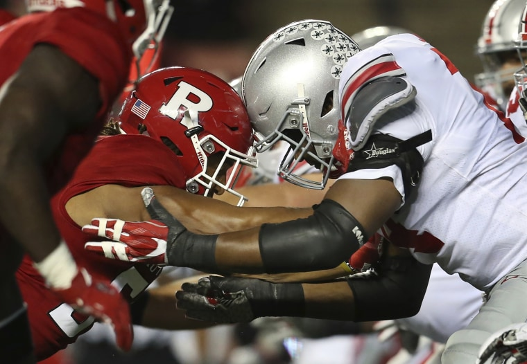 Ohio State offensive and Rutgers defensive linemen go helmet-to-helmet during a college football game on Sept. 30 in Piscataway, New Jersey.