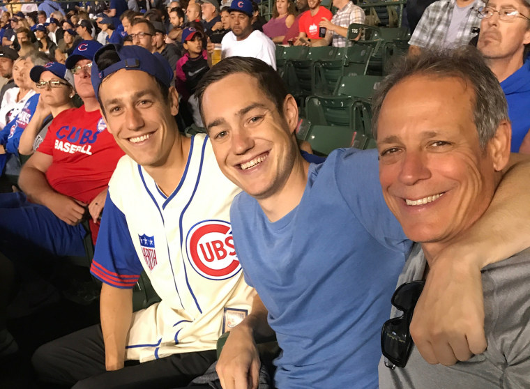 "Image: John ""Jay"" Loos of Schaumburg, right, sits with his sons Adam and Eric, at a Cubs game in Chicago"