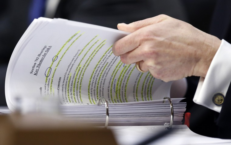 Image: Rosenstein looks through his notes during a Senate Intelligence Committee hearing