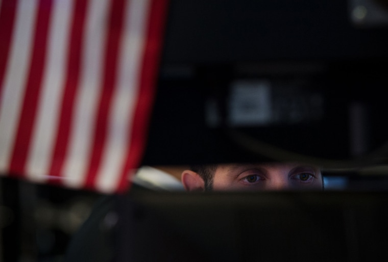 Image: A trader works on the floor at the closing bell of the Dow Industrial Average