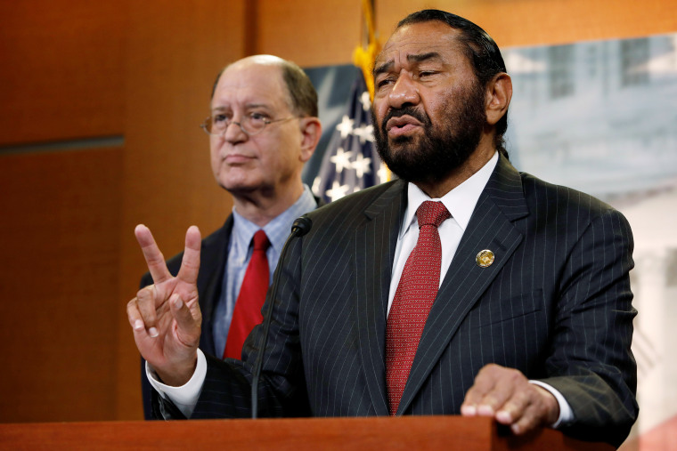 Rep. Al Green (D-TX), accompanied by Rep. Brad Sherman (D-CA), speaks with the media about his plans to draft articles of impeachment against President Donald Trump on Capitol Hill in Washington