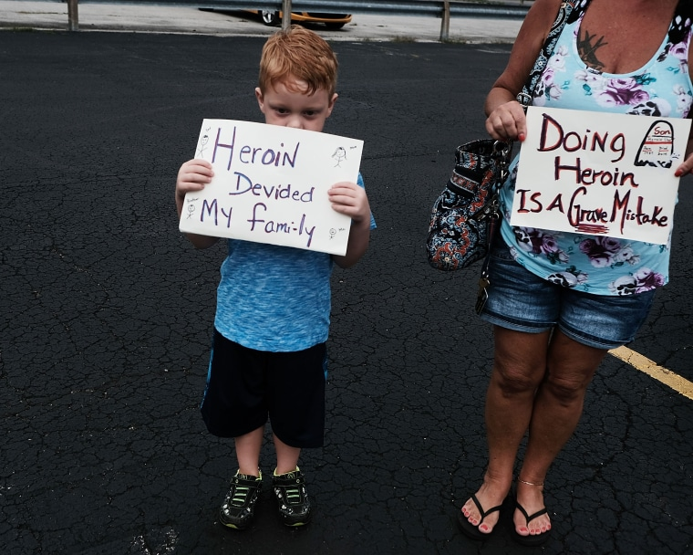 Image: Derrick Slaughter, 5, attends a march against the heroin epidemic with his grandmother