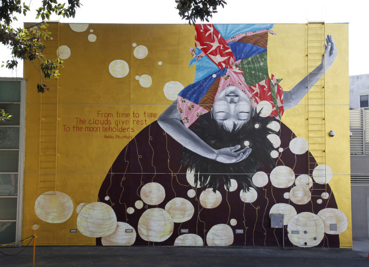"""The """"Moon Beholder"""" mural by Katie Yamasaki at the Japanese American National Museum in Los Angeles."""