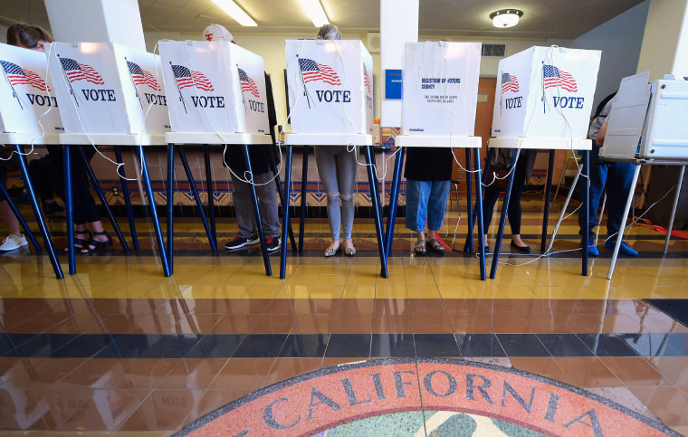 Image: People vote in the U.S. presidential election at Santa Monica City Hall