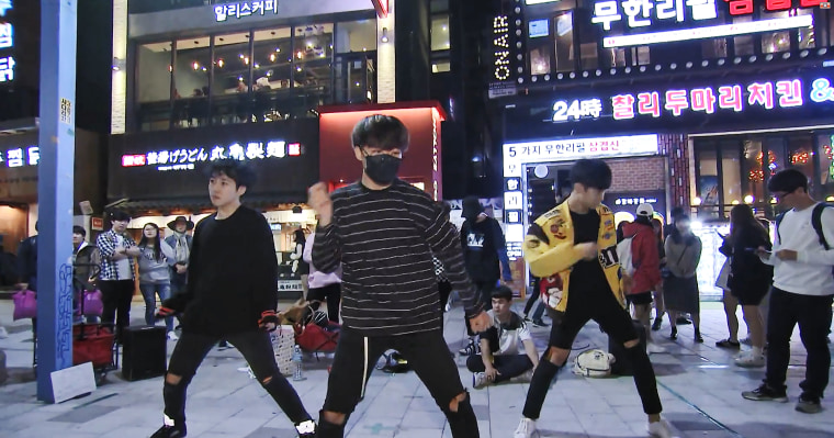 Yang Seung Ho's K-pop dance group performs in Seoul's Hongdae district on Thursday.