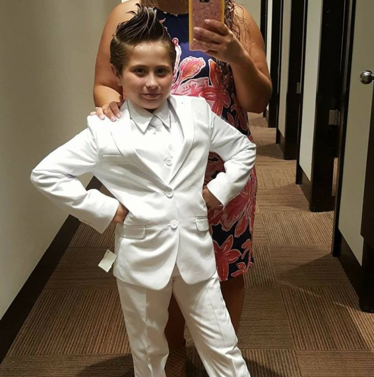Image: Cady Mansell in a white pants suit, which she hoped to wear to her First Holy Communion but was not allowed to do so