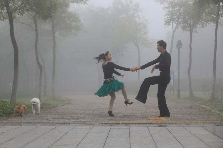 Image: A couple dances in a park in Huai'an, China