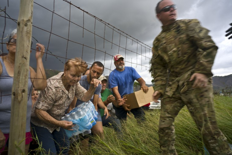 Image: Puerto Rican National Guard deliver food and water, brought via helicopter, to residents of Morovis, Puerto Rico