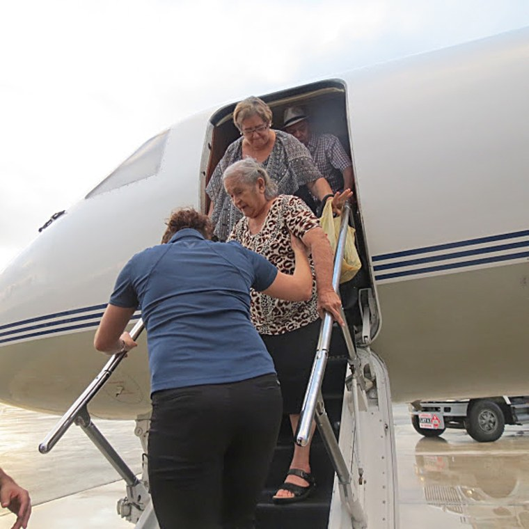 Image: Elderly and ill evacuees from Puerto Rico arrive at Opa Locka Executive Airport in Miami. Their evacuation was coordinated by Fundacion Stefano.