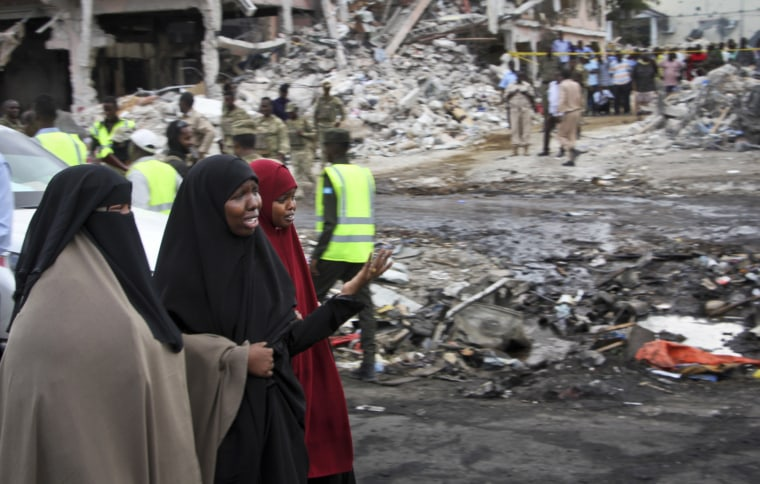 Image: Somali women react at the scene of the blast