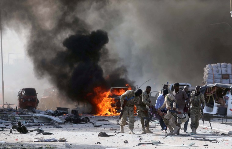 Image: Somali Armed Forces evacuate their injured colleague, from the scene of an explosion in Mogadishu
