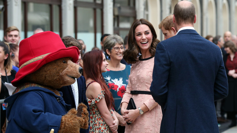 Britain's Prince William, back to camera, Kate, Duchess of Cambridge and Prince Harry meet Paddington Bear at Paddington Station in London, Monday Oct. 16, 2017