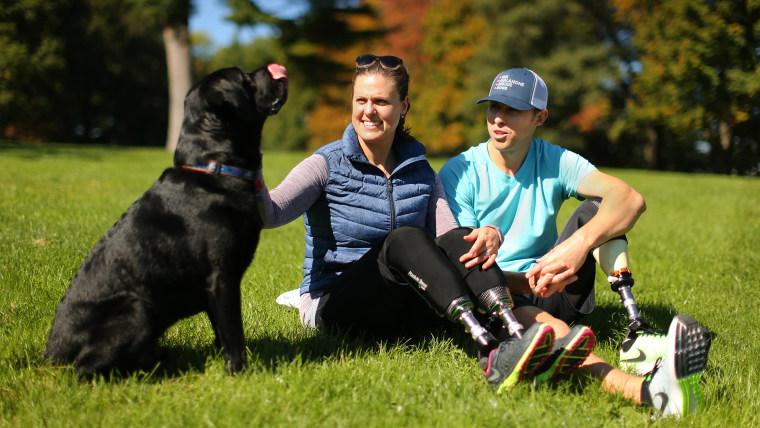 Boston Marathon bombing survivors Jessica Kensky and Patrick Downes with Rescue the dog