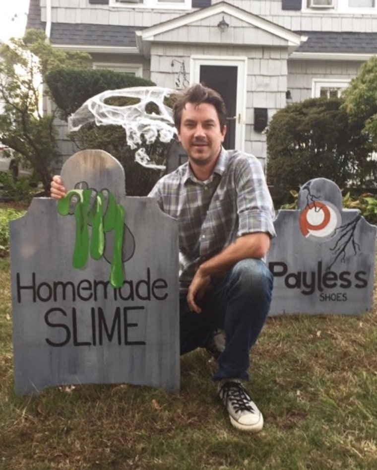 Michael Fry with his gravestone for homemade slime.