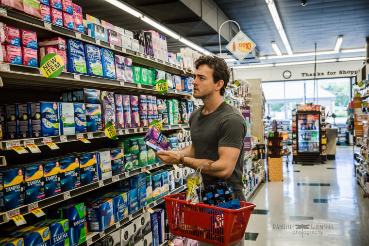 """A man who will buy your tampons? He's a keeper. This photo is called """"Heavy on the errands,"""" from Guenther's """"What Women Want"""" series."""