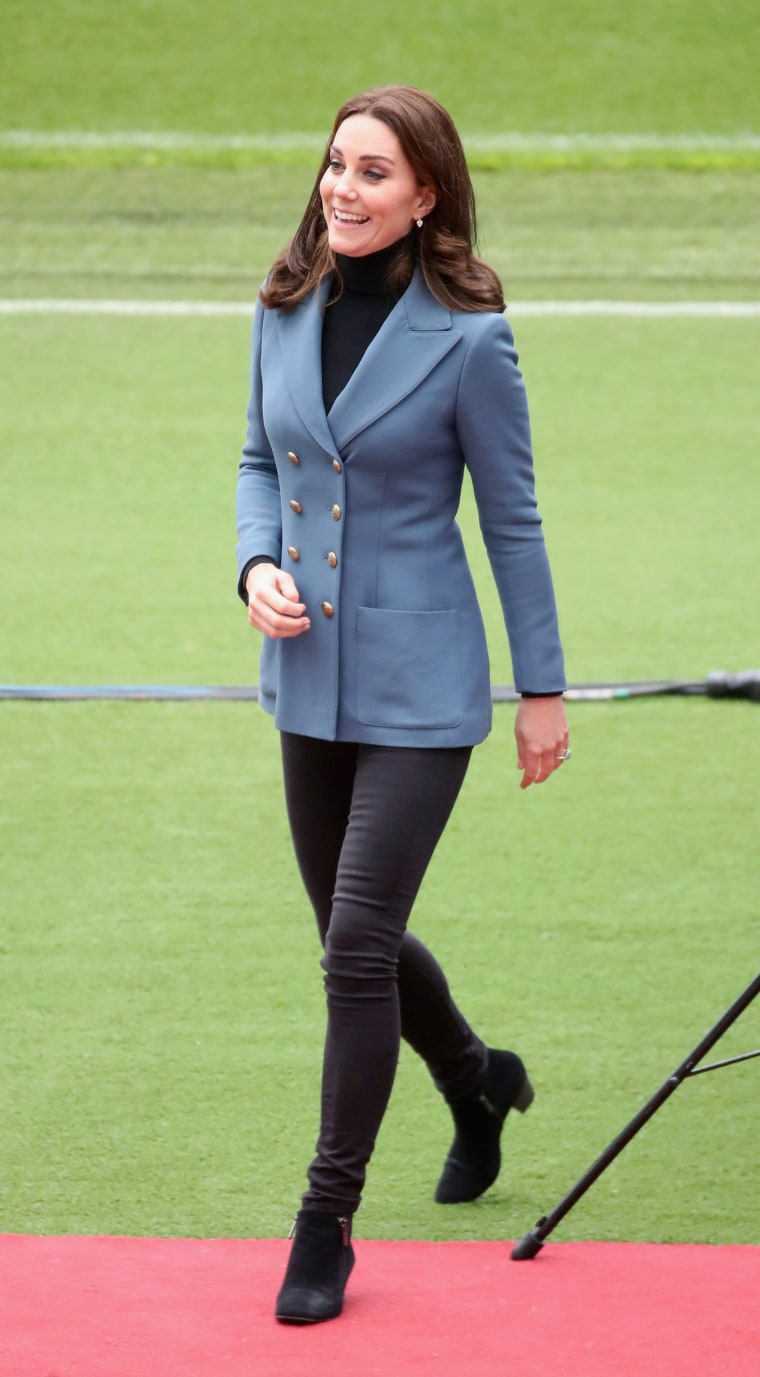 Former Kate Middleton in blue blazer, jeans and ankle boots
