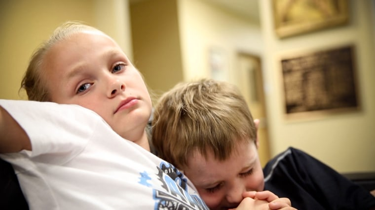 TAMPA, FL: Shaelyn, 10 and her brother Ayden, 9 sit together at the Children's Home Network, a non-profit that helps at-risk children and their families.