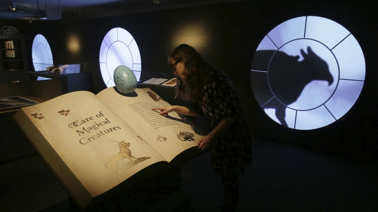 "A member of British Library staff poses for a picture at the ""Harry Potter - A History of Magic"" exhibition at the British Library, in London, Wednesday Oct. 18, 2017"