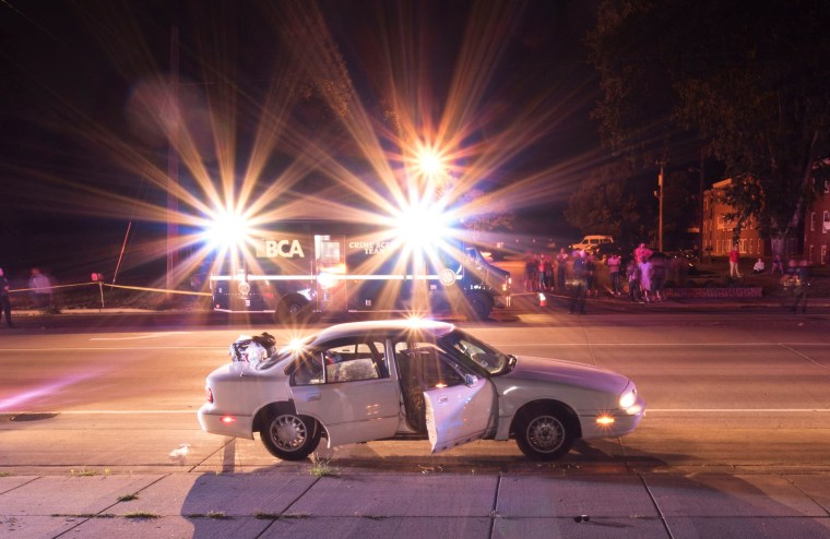 Image: The car of Philando Castile is surrounded by police vehicles