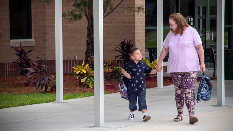 Pennie Krietemeier picks up her 5-year-old grandson Colton from kindergarten.