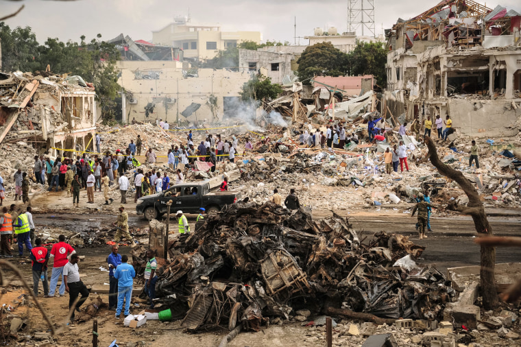 Image: A general view of the scene of the explosion of a truck bomb in the centre of Mogadishu.